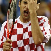 'Marin Cilic of Croatia reacts during his Davis Cup semi-final match against Tomas Berdych of the Czech Republic in Croatia\'s northern Adriatic town of Porec, September 18, 2009.   REUTERS/Nikola Sol