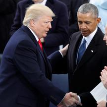 FILE PHOTO: U.S. President Donald Trump greets former Vice President Joe Biden and former President Barack Obama after being sworn in as president of the United States at U.S. Capitol in Washington