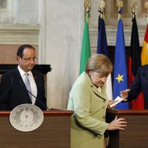 'German Chancellor Angela Merkel (2nd R) leaves followed by Italian Prime Minister Mario Monti (R),  French President Francois Hollande and Spanish Prime Minister Mariano Rajoy (L) after a news confer