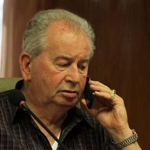 'President of the Argentine Football of Association Julio Grondona speaks on the phone during a meeting in Luque, March 17, 2011. The executive committee of the South American Soccer Confederation (CO
