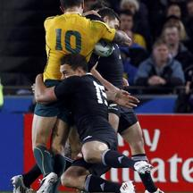 'New Zealand All Blacks\' Sonny Bill Williams (rear) makes an illegal tackle on Australia Wallabies\' Quade Cooper (L) during their Rugby World Cup semi-final match at Eden Park in Auckland October 16