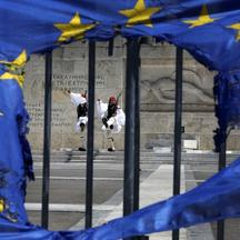 'Presidential guards are framed through a burned EU flag in front of the Tomb of the Unknown Soldier by the parliament in central Syntagma square in Athens May 1, 2013 following a May Day rally. Thous