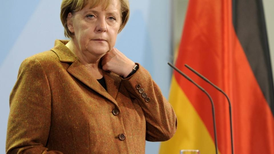 'German Chancellor Angela Merkel gives a press conference following a meeting with Estonian Prime minister Andrus Ansip (not in picture) in Berlin, October 21, 2010.  AFP PHOTO/ODD ANDERSEN'