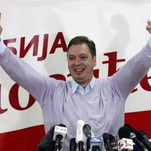 'Serbian Progressive Party deputy president Aleksandar Vucic celebrates party leader and presidential candidate Tomislav Nikolic\'s victory in Belgrade May 20, 2012. Opposition leader Tomislav Nikolic