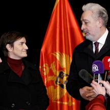 Montenegro's PM Krivokapic (R) welcomes his Serbian counterpart Brnabic to receive a Sputnik V vaccine donation in Podgorica