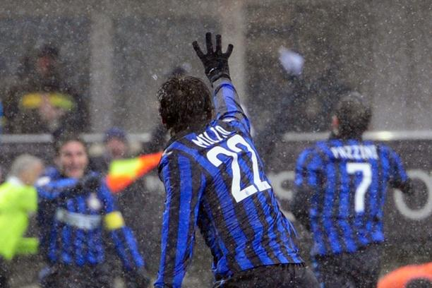 'Inter Milan\'s Argentine forward Milito celebrates after scoring his fourth goal during the Serie A football match between Inter Milan and Palermo at the San Siro Stadium in Milan on February 1, 2012