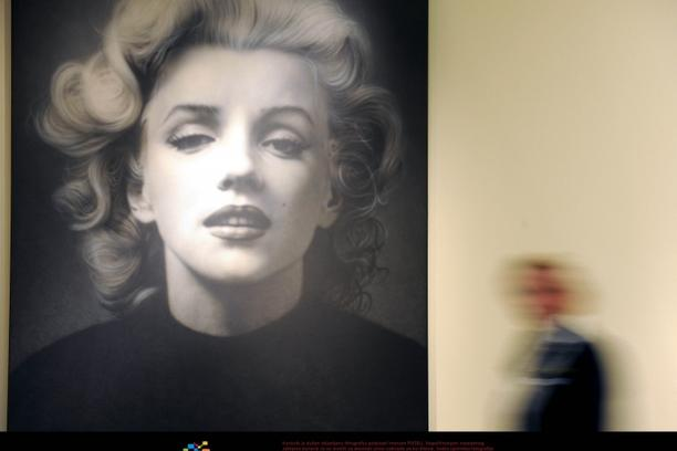 'An employee of the East Frisian State Museum walks past a painting of Russian artist Alexander Timofeev inspired by a photography of U.S. actress Marilyn Monroe made in 1952 in Emden, Germany, 15 Mar