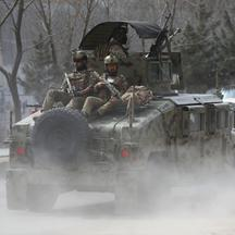 Afghan security forces arrive at the site of an attack in Kabul, Afghanistan