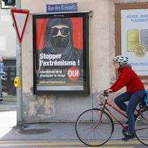 "Poster reads ""Stop Extremism!"" ahead of a Swiss vote on banning face veils in a referendum in Sion"