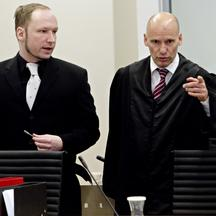 'self-confessed mass murderer and right-wing extremist Anders Behring Breivik talks with his defence lawyer Geir Lippestad in the courtroom on the fifth-day of his murder trial in Oslo on April 20, 20