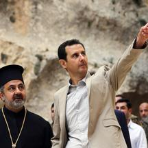 A handout picture taken on April 20, 2014 by the official Syrian Arab News Agency (SANA) shows Syria's President Bashar al-Assad (C) visiting the ancient Christian town of Maalula which his troops recently recaptured from rebels.  AFP PHOTO /HO/SANA  ===