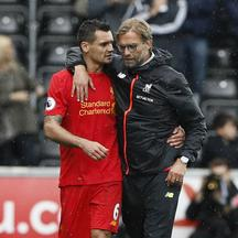 Britain Soccer Football - Swansea City v Liverpool - Premier League - Liberty Stadium - 1/10/16 Liverpool manager Juergen Klopp celebrates with Dejan Lovren at the end of the match  Reuters / Stefan Wermuth Livepic EDITORIAL USE ONLY.