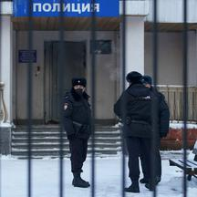 FILE PHOTO: Police officers stand outside a police station where detained Russian opposition leader Navalny is being held, in Khimki