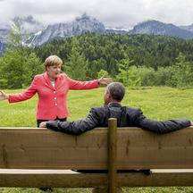 German Chancellor Angela Merkel speaks with U.S. President Barack Obama outside the Elmau castle in Kruen near Garmisch-Partenkirchen, Germany, June 8, 2015. Leaders of the Group of Seven (G7) industrial nations vowed at a summit in the Bavarian Alps on S