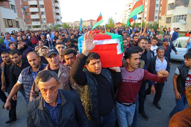 People carry the coffin of a member of Azerbaijani Armed Forces who was allegedly killed during the fighting over the breakaway region of Nagorno-Karabakh, in Tartar district