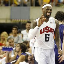 'U.S. Olympic basketball player LeBron James gestures during an exhibition game against Spain ahead of the 2012 London Olympic Games at Palau Sant Jordi in Barcelona July 24, 2012. REUTERS/Gustau Naca