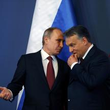 Russian President Vladimir Putin discuss with Hungarian Prime Minister Viktor Orban (R) before a joint news conference in Budapest February 17, 2015. Putin will discuss Russian gas supplies to Hungary when he visits Budapest on Tuesday, an adviser to the