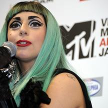'US top entertainer Lady Gaga delivers a message during a press conference of the MTV video Music Aid Japan event in Tokyo on June 23, 2011.  Lady Gaga is here to  attend a charity music event for the