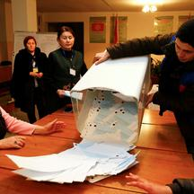 Members of a local electoral commission empty a ballot box after polls closed during a presidential election and constitutional referendum in Arashan