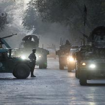 Afghan security forces leave the site of an incident after an attack at the university of Kabul