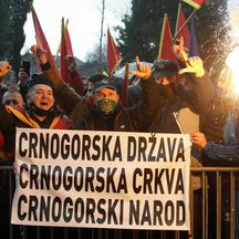 Protestors shout slogans during a rally ahead of a vote for the amendments of Law on Religious Freedoms, in Podgorica