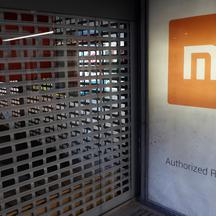 Xiaomi logo is seen on a closed brand's store in central Kiev
