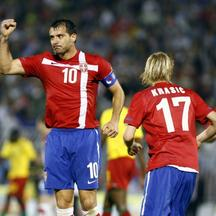 'Serbia's Dejan Stankovic (L) celebrates with team-mates Milos Krasic (C) and Nenad Milijas after scoring against Cameroon during their international friendly soccer match in Belgrade June 5, 2010.