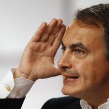 'Spain\'s Prime Minister Jose Luis Rodriguez Zapatero delivers his speech during a party meeting in the Andalusian capital of Seville February 13, 2011. REUTERS/Marcelo del Pozo (SPAIN - Tags: POLITIC