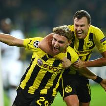 'Dortmund\'s defender Marcel Schmelzer (L) celebrate scoring the 2-1 goal with teammate midfielder Kevin Grosskreutz during the UEFA Champions League Group D football match BVB Borussia Dortmund vs Re