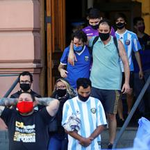People leave the Casa Rosada presidential palace after attending the wake of late soccer legend Diego Maradona, in Buenos Aires