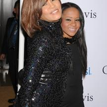 'WORLD RIGHTS EXCEPT USA, FINLAND, SWEDEN, DENMARK, NORWAY AND ICELAND.  Whitney Houston and daughter Bobbi Kristina at the 2011 Pre-GRAMMY Gala and Salute To Industry Icons Honoring David Geffen at T