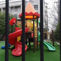 Playground is seen through the fence of a closed kindergarten in Wuhan, the epicentre of the novel coronavirus outbreak