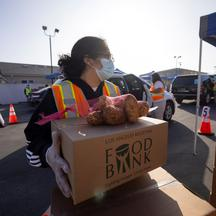 The Los Angeles Regional Food Bank distributes food outside a church during the outbreak of the coronavirus disease (COVID-19) in Los Angeles