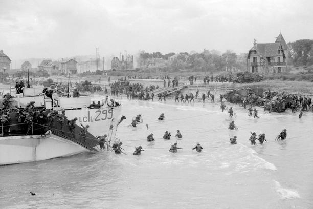 Canadian troops come ashore at a Juno Beach landing area on D-Day at Bernieres Sur Mer,