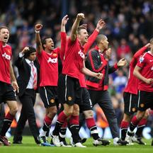 'Manchester United players celebrate on the final whistle in the English Premier League football match between Blackburn Rovers and Manchester United at Ewood Park, Blackburn, north-west England on Ma
