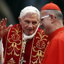 'REFILE - CORRECTING COUNTRY IN BYLINE    Pope Benedict XVI (L) waves during a mass conducted by Cardinal Tarcisio Bertone (R) for the 900th anniversary of the Order of the Knights of Malta, at the St
