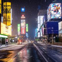 Snow begins to fall in Times Square during a snow storm, during the coronavirus disease (COVID-19) pandemic in the Manhattan borough of New York City