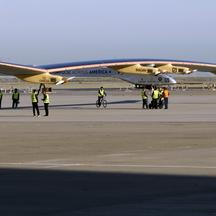 'Crew members walk the Solar Impulse to its hangar following a test flight at Moffett Field in Mountain View, California April 19, 2013. The aircraft, made of carbon fiber sheets and powered by solar