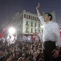 'Alexis Tsipras, the head of Greece\'s leftist SYRIZA party, waves at supporters during a pre-election rally in Athens June 14, 2012. Tsipras promised on Thursday to rip up the conditions attached to