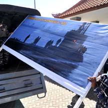 Indonesian Navy personnel carry a banner as they prepare the commander post for the searching operation of the submarine KRI Nanggala-402