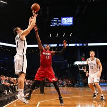 Nov 17, 2014; Brooklyn, NY, USA; Brooklyn Nets guard Bojan Bogdanovic (44) shoots for three over Miami Heat guard Mario Chalmers (15) during the third quarter at Barclays Center. Miami Heat won 95-83. Mandatory Credit: Anthony Gruppuso-USA TODAY Sports