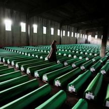 FILE PHOTO: Bosnian Muslim woman searches coffins in Potocari
