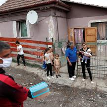 FILE PHOTO: A Roma activist carries food for donation to families in a deprived Roma neighbourhood during the coronavirus outbreak in Miskolc, Hungary