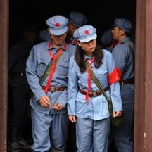 'Photo taken on September 21, 2012 shows visitors dressed in red army uniforms visiting places former Chinese leader Mao Zedong used to stay, during an educational tour in Jinggangshan in central Chin