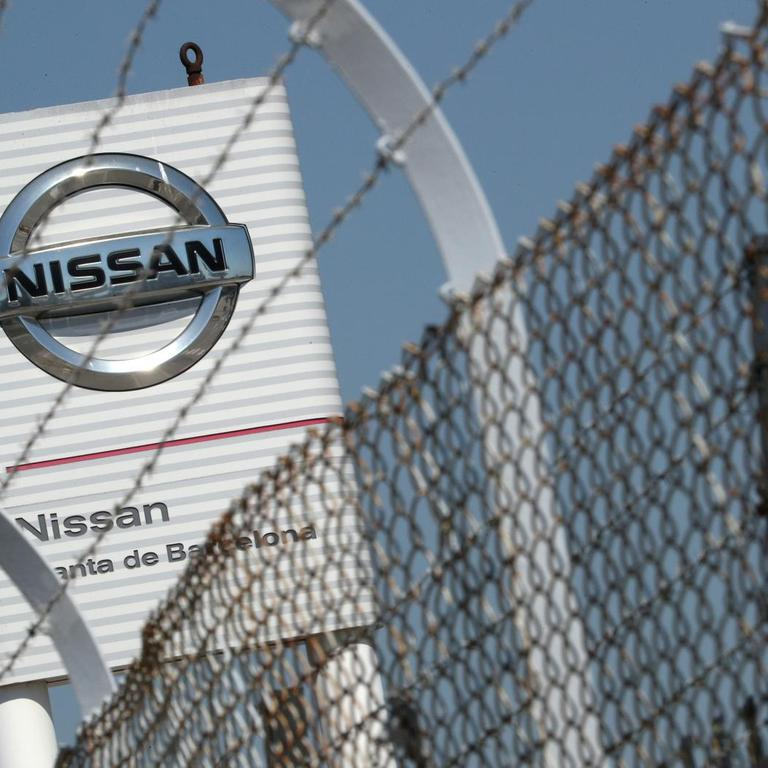 FILE PHOTO: The logo of Nissan is seen through a fence at Nissan factory at Zona Franca during the coronavirus disease (COVID-19) outbreak in Barcelona