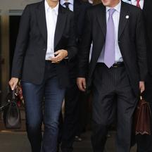 'France\'s Finance Minister Christine Lagarde (L) and Bank of France Governor Christian Noyer smile as they leave the G20 Finance Ministers and Central Bank Governors meeting in Gyeongju, southeast of