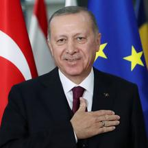 FILE PHOTO: Turkish President Tayyip Erdogan reacts ahead of a meeting with EU Council President Charles Michel pose in Brussels