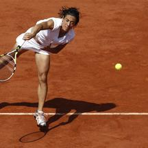 'Italy\'s Francesca Schiavone returns the ball to Australia\'s Samantha Stosur during their women\'s final match  in the French Open tennis championship at the Roland Garros stadium, on June 5, 2010,