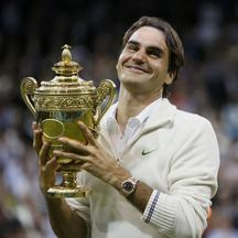 'REFILE - CORRECTING BYLINE  Roger Federer of Switzerland holds the winners trophy after defeating Andy Murray of Britain in their men\'s singles final tennis match at the Wimbledon Tennis Championshi