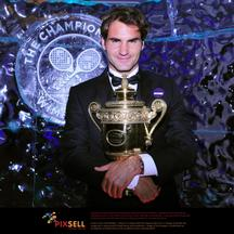 'Switzerland\'s Roger Federer holds the Men\'s Singles Trophy during the Champions Ball at the Intercontinental Hotel, London. Photo: Press Association/Pixsell'